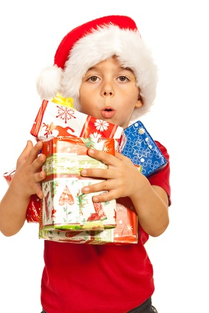 Little kid boy with santa hat holding many Christmas gifts in his arms isolated on white background Stock Photo - 16374565