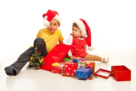 Happy kids with many Christmas gifts isolated on white background photo