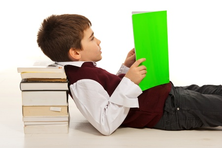 Student boy resting head on stack of books and reading photo
