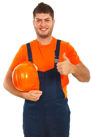 Successful builder worker giving thumb up isolated on white background photo