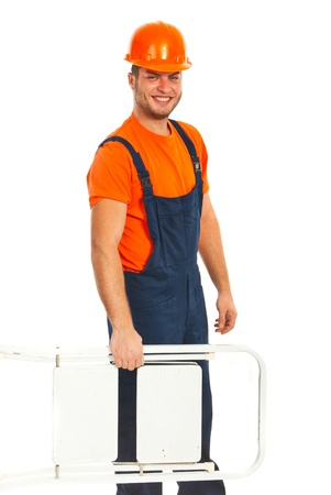step ladder: Happy worker carrying step ladder isolated on white background