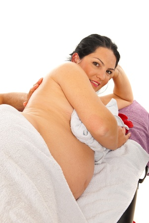 Happy pregnant woman receive back massage isolated on white background Stock Photo - 16436641