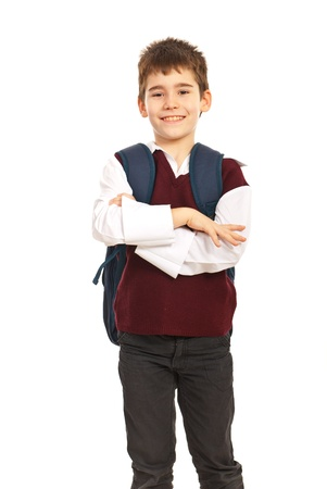 Cheerful school boy with arms folded isolated on white background photo