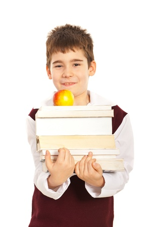 Student boy carrying stack of books and apple isolated on white background photo