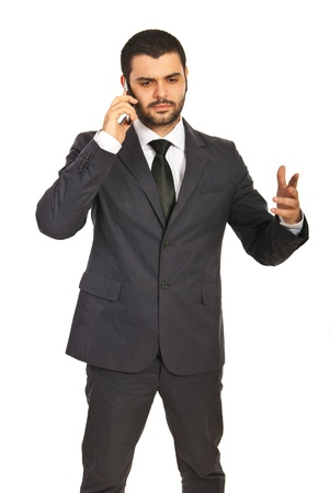 gesticulate: Business man having conversation by phone mobile and gesticulate with his hand isolated on white background Stock Photo