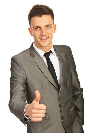 Happy business man giving thumb up isolated on white background photo