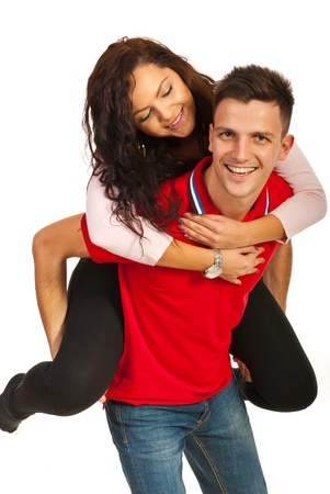 Happy  young couple in piggy back isolated on white background photo