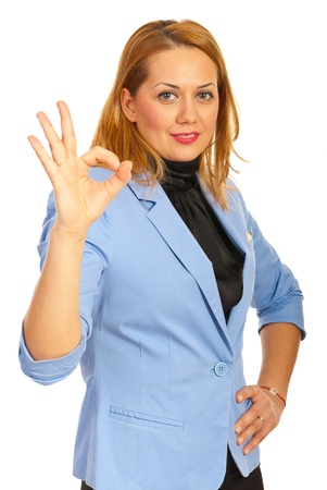 Corporate woman showing okay sign hand gesture isolated on white background photo