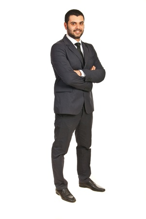 folded hands: Full length of happy executive male isolated on white background