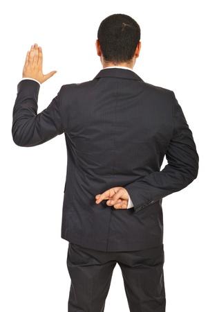 untruth: Back of executive man liar swearing false isolated on white background