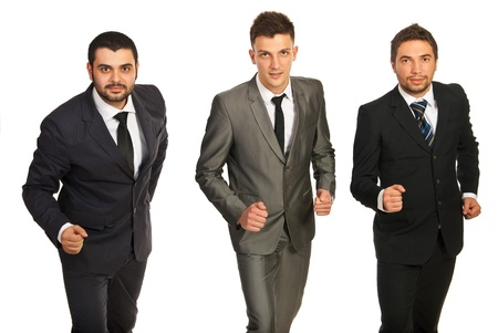 Three business men in a line being ready for competition isolated on white background Stock Photo - 16974496
