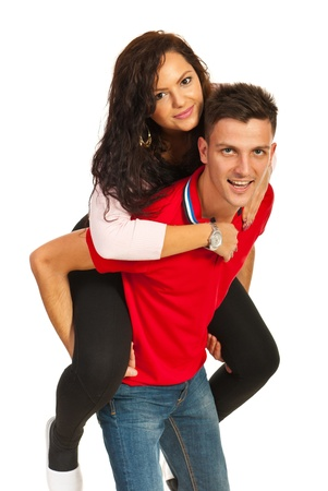 Cheerful couple  playing piggy back isolated on white background photo