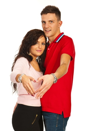 Young couple making heart shapoe with their hands isolated on white background photo