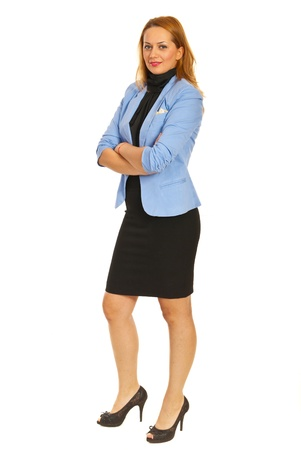 folded hands: Beauty business woman standing with arms folded isolated on white background Stock Photo