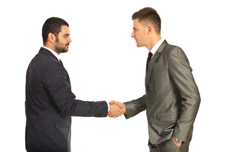 Two business men giving handshake isolated on white background photo