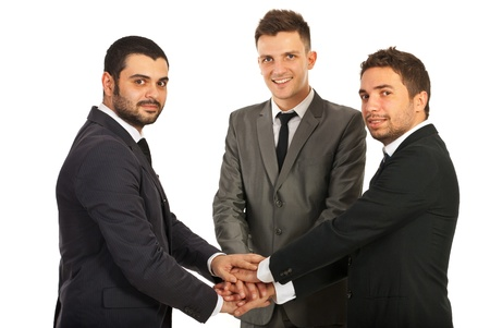 United happy team of three business men standing with hands  on top each other isolated on white background Stock Photo - 16966129