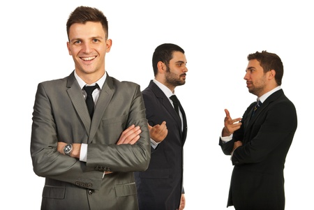 Happy executive man in front of his team who having aconversation isolated on white background Stock Photo - 16966126