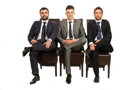 Elegant three business men sitting on chairs in a line isolated on white background Stock Photo - 16966092