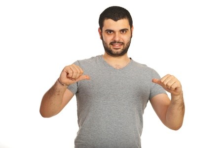 Casual man pointing with both hands to his blank gray t-shirt isolated on white background photo