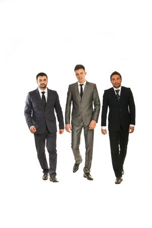 Three business men walking isolated on white background Stock Photo - 17034161