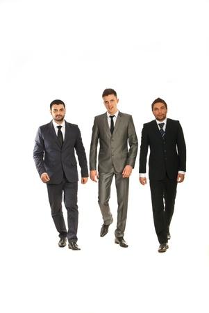 Three business men walking isolated on white background Stock Photo - 17034161