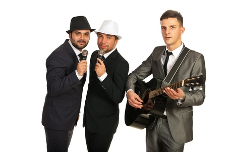 Musiacl band of three men,one playing guitar and two singing to microphones Stock Photo - 17034173