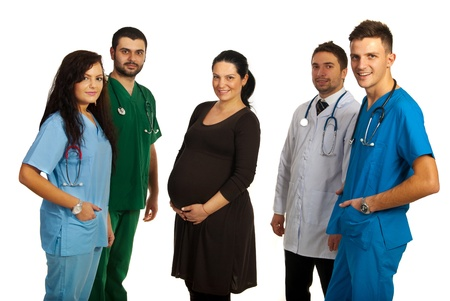 Pregnant woman in the middle of group of doctors isolated on white background Stock Photo - 17034231
