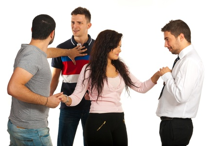 flirting women: Woman flirting with one man while her boyfriend fighting with other man for same woman isolated on white background