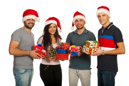 four friends: Happy group of four friends holding Christmas gifts isolated on white background