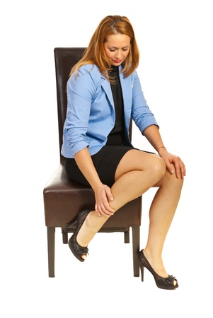 injured woman: Tired business woman having legs pain isolated on white background Stock Photo