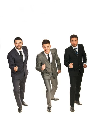 Three business men standing in a line and being ready for start competition isolated on white background Stock Photo - 17034082