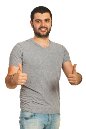 Casual man with blank gray tshirt giving thumb up isolated on white background photo