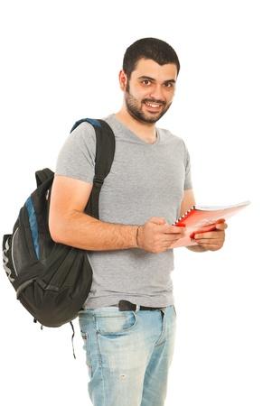 estudiantes universitarios: Feliz estudiante cuadernos Hombre que sostiene aislados en fondo blanco