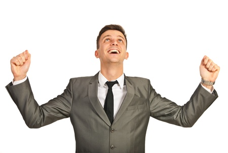 raising hand: Successful business man cheering isolated on white background Stock Photo