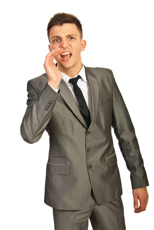 Business man shouting isolated on white background photo