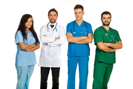 folded hands: Group of four different doctors standing with arms folded isolated on white background Stock Photo