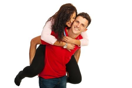 piggy back: Loving happy couple in piggy back isolated on white background Stock Photo