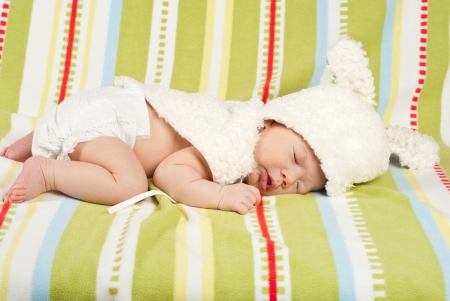 Sleeping little Easter newborn baby with bunny hat Stock Photo - 18730549