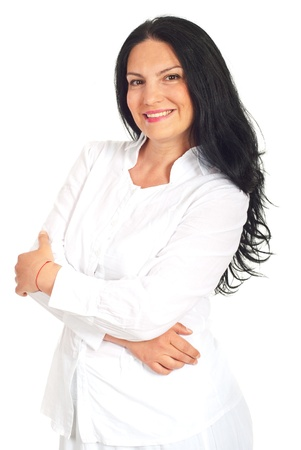 Happy casual woman in white clothes standing with arms folded isolated on white background photo