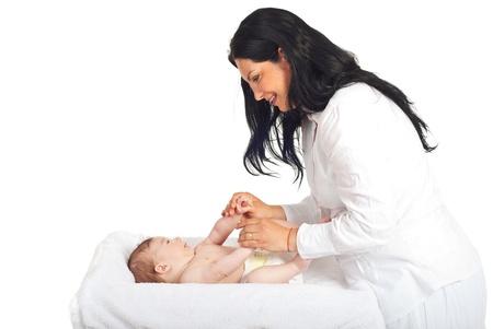 Mother caring newborn baby boy isolated on white background photo