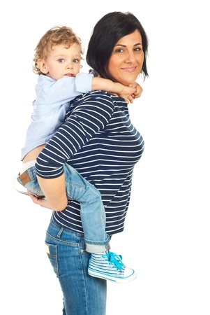 Smiling mother and son in piggy back isolated on white background photo