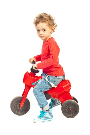 Toddler boy riding bicycle isolated on white background