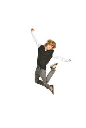 Jumping schoolboy raising his hands isolated on white background photo