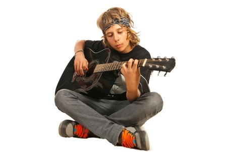 boy playing guitar: Rocker teen with bandana playing accoustic guitar isolated on white background