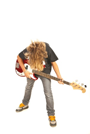 Bassist teen boy with electric bass guitar isolated on white background photo