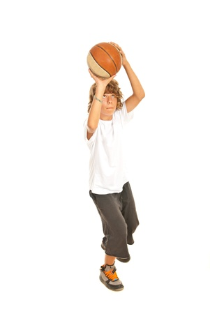 child ball: Young boy throwing basketball isolated on white background Stock Photo