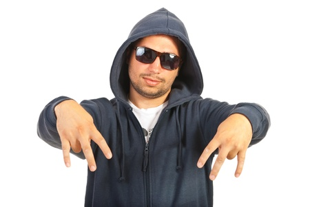 Hooded rapper man gesture with his fingers isolated on white background Stock Photo