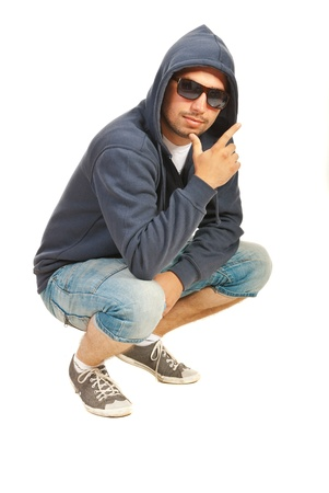 Rapper man posing and gesturing isolated on white background photo