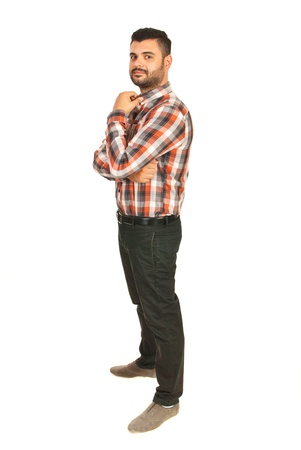 mans shirt: Full length of business mans tanding in profile and holkding hand to collar shirt isolatedon white background Stock Photo
