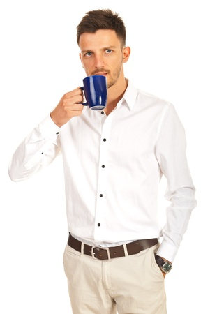 Young modern business man drinking cup of coffee isolated on white background photo